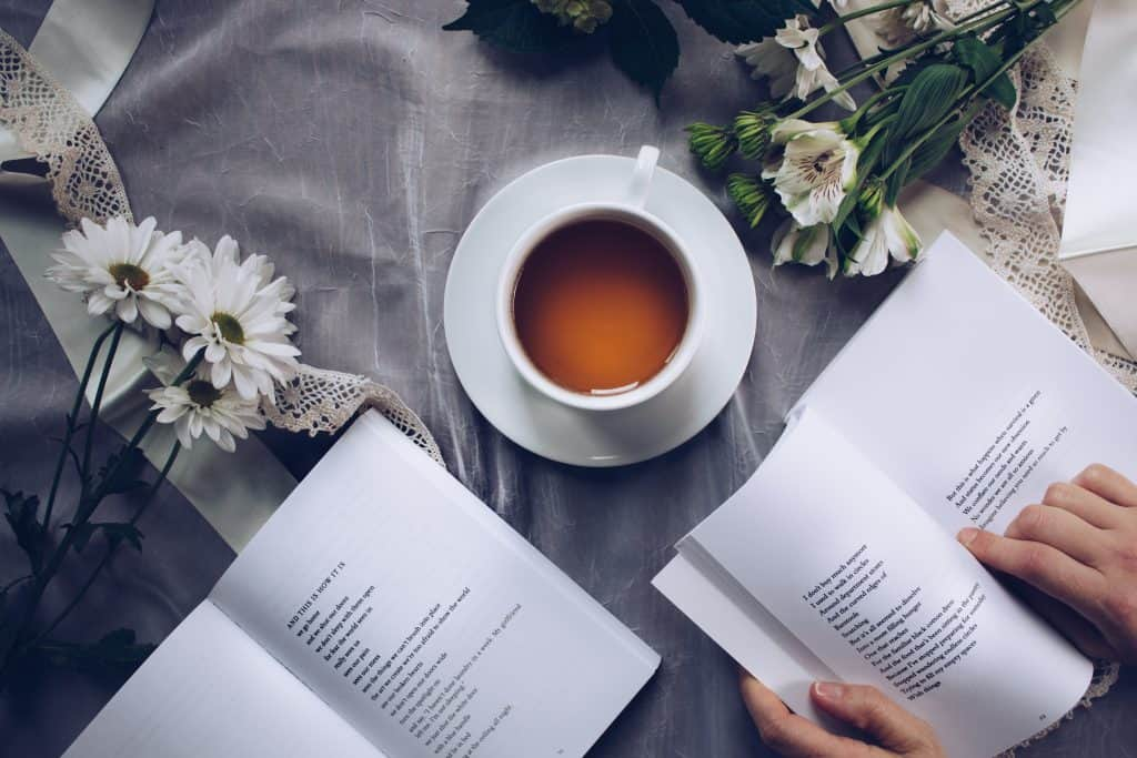 two books of poetry on table with tea
